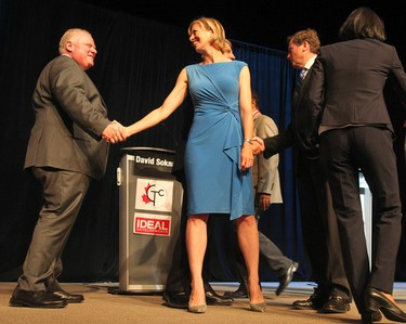Toronto Mayor Rob Ford and mayoral candidate Karen Stintz shake hands at the debate at Global Kingdom Ministries in Scarborough on Tuesday, July 15, 2014. (STAN BEHAL/Toronto Sun)