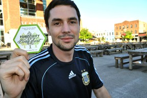 Forest City Beer Fest founder Aaron Brown sits in front of Covent Garden Market in London Ont. July 15, 2014. (File photo)