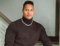 "Dwayne ""The Rock"" Johnson -  then known as Rocky -  poses as a SUNshine Boy in 1997. (Photo: Kate ​MacConnell, QMI Agency)"