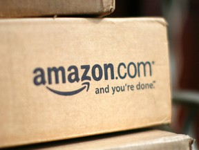 A box from Amazon.com is pictured on the porch of a house in Golden, Colorado in this file photo taken July 23, 2008.  REUTERS/Rick Wilking/Files