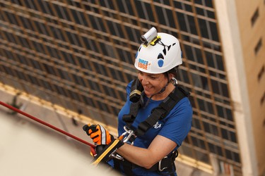 Joumana Ghandour, the general manager of the Westin Edmonton, ropes down the 20-storey hotel during Make-A-Wish Northern Alberta's Rope for Hope fundraiser at the Westin hotel in Edmonton, Alta., on Wednesday, July 16, 2014. The fundraiser helps raise awareness to allow the organization to grant wishes to sick children. Ian Kucerak/Edmonton Sun/QMI Agency
