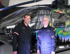 Phoenix Heli-Flight president Paul Spring (right)) and chief pilot Darrel Peters pose with their newly unveiled HERO 1 Helicopter Tuesday night, which will help them provide 24-hour medevac service for the region. Aimée Harper/TODAY STAFF Today staff