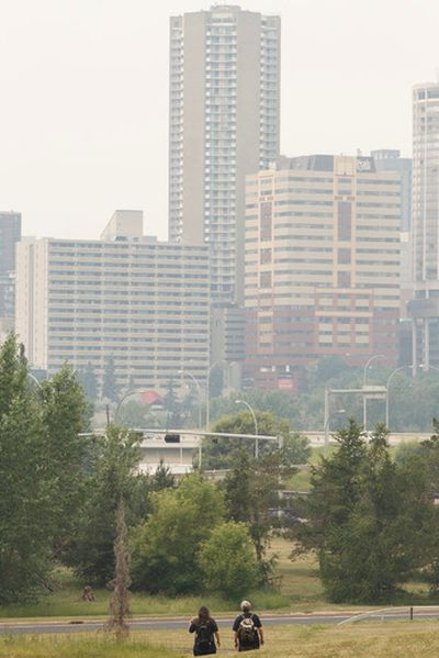 Bad, smoky air is seen from a park near the Muttart Conservatory in Edmonton, Alta., on Wednesday, July 16, 2014. Air quality warnings were issued throughout the day, as smoky air from area wildfires drifted over the city. Ian Kucerak/Edmonton Sun/QMI Agency