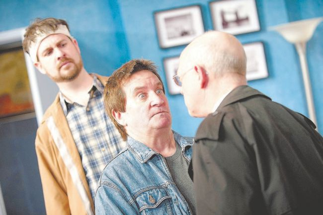 Beleaguered cabbie John Smith (David Leyshon), left, watches as his upstairs neighbour Stanley Gardner (Michael Lamport) explains matters to Det.-Sgt. Troughton (David Talbot) in the Huron Country Playhouse production of Run For Your Wife. (Scott Williams, Special to QMI Agency)