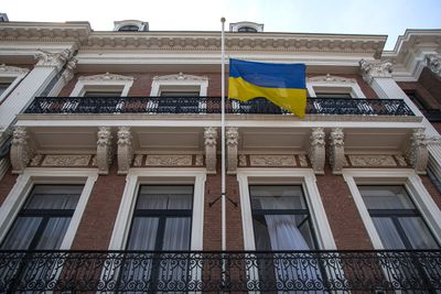 The Ukrainian national flag flies at half-staff at the Ukrainian embassy in The Hague July 18, 2014. More than half the 298 victims aboard Malaysia Airlines flight MH17 heading from Amsterdam for Kuala Lumpur were Dutch, a loss keenly felt in a country of just 15 million people. Flags were at half-staff across the country in memory of the dead. REUTERS/Cris Toala Olivares