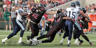 The Ottawa RedBlacks took on the Toronto Argonauts during their home opener at TD Place at Lansdowne Park in Ottawa Friday July 18,  2014. Ottawa RedBlacks go after Ricky Ray from the Toronto Argonauts Friday. Tony Caldwell/Ottawa Sun/QMI Agency