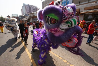A lion dance is performed by members of the Hong De Athletic Association during the K-Days Parade in downtown Edmonton, Alta., on Friday, July 18, 2014. The fair runs at Northlands until July 27. Ian Kucerak/Edmonton Sun/QMI Agency