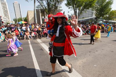 A Captain Hook with the Children's Wish organization waves during the K-Days Parade in downtown Edmonton, Alta., on Friday, July 18, 2014. The fair runs at Northlands until July 27. Ian Kucerak/Edmonton Sun/QMI Agency