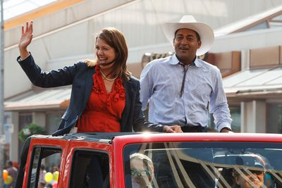 Wildrose Party leader Danielle Smith (left) and Alberta Liberal Party leader Raj Sherman are seen during the K-Days Parade in downtown Edmonton, Alta., on Friday, July 18, 2014. The fair runs at Northlands until July 27. Ian Kucerak/Edmonton Sun/QMI Agency