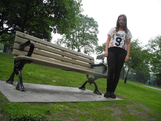 Alyson Kearnan-Leitch, 16, stands at the Gibbons Park bench from which a memorial plaque was stolen. (DALE CARRUTHERS, The London Free Press)