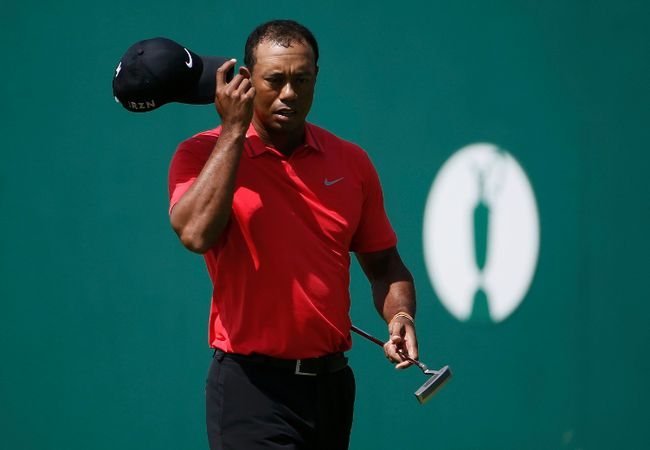 Tiger Woods of the U.S. tips his cap on the 18th green after finishing his final round of the British Open Championship at the Royal Liverpool Golf Club in Hoylake, northern England July 20, 2014. (REUTERS)