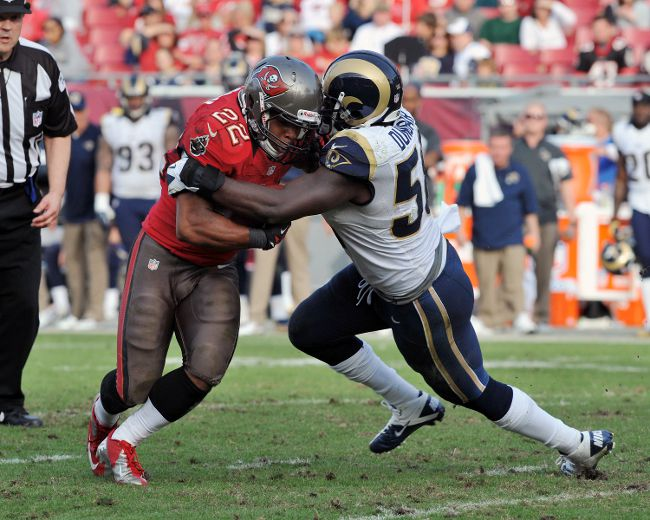 Linebacker Jo-Lonn Dunbar #58 of the St. Louis Rams tackles running back Doug Martin #22 of the Tampa Bay Buccaneers December 23, 2012 at Raymond James Stadium in Tampa, Florida. (Al Messerschmidt/Getty Images/AFP)