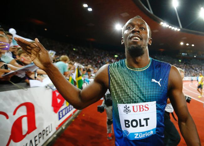 Usain Bolt of Jamaica celebrates after winning the men's 100 metres at the Weltklasse Diamond League athletics meeting in Zurich August 29, 2013. (REUTERS)