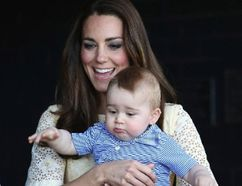 Catherine, Britain's Duchess of Cambridge, holds her son Prince George as they meet a Bilby which has been named after the young prince at Taronga Zoo in Sydney April 20, 2014. REUTERS/Chris Jackson