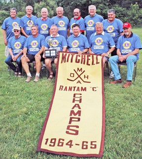 The Mitchell Bantam 'C' champions of 1964-65 pose for a team photo 50 years later, during the 50th anniversary celebration of the town's first OMHA championship win. Back row (left): Rick Heinbuck, Jurri Hoekstra, Greg Strathdee, Rick O'Donnell, Dave O'Donnell, Charlie Pickard and Randy Heinbuck. Front row (left): Fred Vock, Dan Gloor, Jim Houze, Harvey Willows *(in place of Bill Wolfe), Bill Walkom and Bob McGill.  *Note: Bill Wolfe was not present on July 12 and played with the team during the playoffs only. Harvey Willows was the goalie during the regular season but could not play in the playoffs because he was from outside the town of Mitchell and resided in the country. He was replaced by Wolfe for the 1964-65 playoff run. KRISTINE JEAN/MITCHELL ADVOCATE