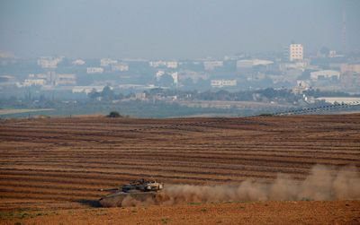 An Israeli tank moves near the border with Gaza during an infiltration by Palestinian militants July 21,  2014.  REUTERS/Baz Ratner