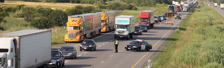 <p>An OPP officer directs traffic as the Hwy. 401 westbound is closed due to a bus fire just west of exit 758 in Morrisburg on Monday. Westbound traffic was closed and being rerouted through Morrisburg.</p><p>ERIC HEALEY/CORNWALL STANDARD-FREEHOLDER/QMI AGENCY