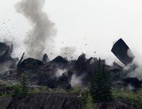 Goldcorp has suspended blasting at the Hollinger open pit project until further notice after a blast occurred Tuesday and a flying piece of rock hit a company vehicle. Photo shows a blast that took place in June. QMI / Timmins Times LOCAL NEWS photo by Len Gillis.