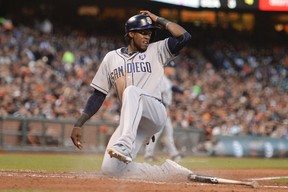 San Diego Padres center fielder Cameron Maybin (24) scores on a ground out by right fielder Will Venable (25, not pictured) against the San Francisco Giants during the fifth inning at AT&T Park on June 24, 2014 in San Francisco, CA, USA (Kyle Terada/USA TODAY Sports)