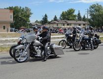 Jenna Dulewich HIGH RIVER TIMES/QMI AGENCY The bikers start their run for the Leather & Chaps Ridin' for SNAPS 4th annual fundraiser on Saturday, July 19th at the High River Royal Canadian Legion.