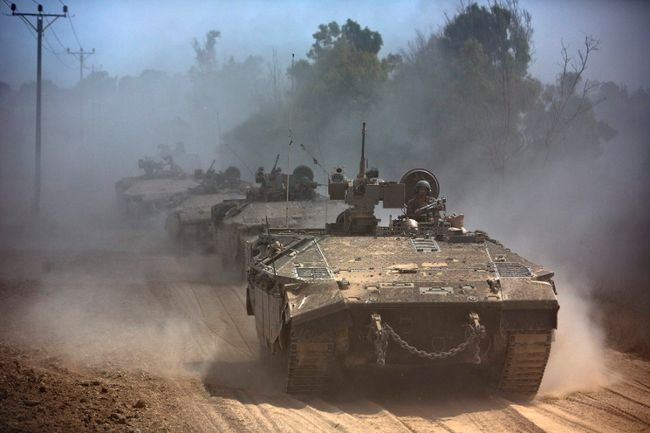 Israeli APCs drive near the Israeli border with Gaza as the come out of the Gaza Strip July 25, 2014. (REUTERS/Nir Elias)