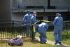 Calgary City Police Crime Scene Investigators enter the scene of the suspicious death of a woman inside a southeast Calgary home on Saturday, July 26, 2014. Police have since declared the woman's death the city's 21st homicide of the year. Stuart Dryden/Calgary Sun/QMI Agency