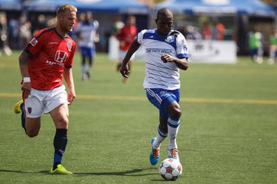 Edmonton defender Lance Laing (right) is chased by Indy defender Andrew Stone (left) during a NASL soccer game between FC Edmonton and the Indy Eleven at Clark Stadium in Edmonton, Alta., on Sunday, July 27, 2014. The Eddies lost 0-1 in extra time. Ian Kucerak/Edmonton Sun/QMI Agency