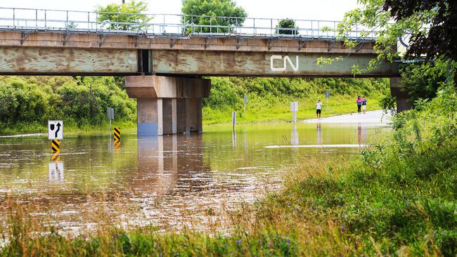 Fourth Ave. between Third and Seventh St.'s Louth was closed due to excessive flooding. Crews were busy setting up pylons and blocking off roads in parts of Niagara after rains caused major damage and flooding to roads. July 28, 2014. 