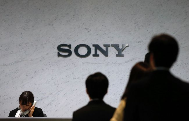 A receptionist speaks on a phone under a Sony Corp logo at the company's headquarters in Tokyo, in this file picture taken Feb. 6, 2014.     REUTERS/Toru Hanai/Files