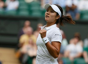 Li Na of China reacts after defeating Paula Kania of Poland in their women's singles tennis match at the Wimbledon Tennis Championships, in London June 23, 2014. (REUTERS/Stefan Wermuth)