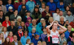 Derek Drouin of Canada reacts as he competes on his way to a first place finish in the Men's High Jump final at the 2014 Commonwealth Games in Glasgow, Scotland, July 30, 2014. (REUTERS/Suzanne Plunkett)