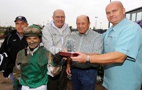 John Short (centre) presents (left to right) Dale Saunders, Fernando Perez, Pat Schaffer, and Charlie Garvey with the Sun Sprint trophy, after Ready Racer won the 37th Running of The Sun Sprint Championship in  September 2013. David Bloom/Edmonton Sun