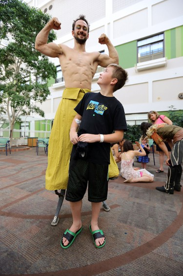 A cast members of Odysseo pose for a photo with 11 year old Nikolai Philipenko at the Stollery Hospital in Edmonton, Alberta on July 30, 2014. The cast came to the hospital to entertain the kids who cannot make it to the show. Perry Mah/Edmonton Sun/QMI Agency