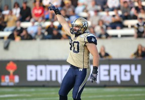 Bomber Greg Peach celebrates a sack during CFL game action against the Hamilton Tiger-Cats on July 31, 2014.