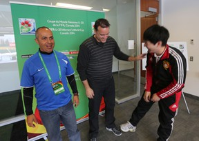 From left to right, Brazil coach Adilson Galdino dos Santos, United States official James Moorhouse, and China official Fred Li share a laugh during a visit to Commonwealth Stadium last March in prepartion for the 2014 FIFA U20 Women's World Cup. Perry Mah/Edmonton Sun