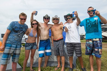 Steve Wurz (centre) from Silvan Lake, Alta., poses for a photo with his friends during Big Valley Jamboree 2014 in Camrose, Alta., on Sunday, Aug. 3, 2014. Ian Kucerak/Edmonton Sun/QMI Agency