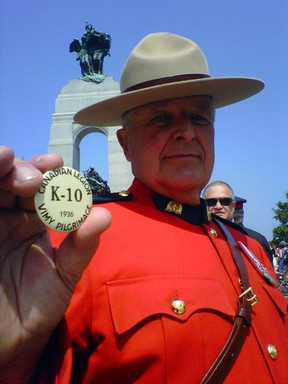 Retired RCMP Staff Sgt. Garth Hampson of Blackburn Hamlet keeps a button belonging to his father, L/Cpl Sid Hampson, who was with the 10th Battalion, close to his chest. Kelly Roche/Ottawa Sun