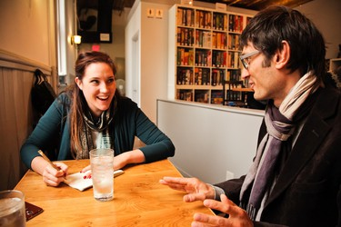 Sarah and Clinton debate the best board game at Across The Board game cafe in Winnipeg. (HANDOUT/Leif Norman)