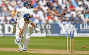 India captain Mahendra Singh Dhoni is run out by England's James Anderson during their match last month in Nottingham, England. (REUTERS)