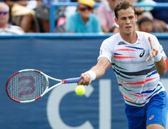 Vasek Pospisil hits a forehand against Milos Raonic in the men's singles final at the Citi Open tennis tournament in Washington, D.C. on Aug. 3, 2014. (Geoff Burke/USA TODAY Sports)
