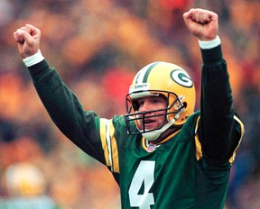 Green Bay Packers quarterback Brett Favre reacts after completing a touchdown pass during the NFC divisional playoff game in Green Bay in this January 4, 1998 file photo. (REUTERS/Stringer/Files)