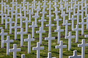 Crosses are seen at the cemetery outside the WWI Douaumont ossuary near Verdun, northeastern France, in this March 30, 2014 file picture. The cemetery is the largest single French military cemetery of the World War One with more than 16,142 graves. Hundreds of thousands of French and Germany soldiers were killed during the battle of Verdun.The fields and woods around Verdun, site of one of the most devastating protracted battles of World War One, may now appear tranquil. But remnants of the war - unexploded ordnance - still pose a threat 100 years on. The 10-month Battle of Verdun ranks among the bloodiest encounters in the Great War, its unrelenting hailstorm of ammunition having killed hundreds of thousands French and German soldiers from February to December 1916. Picture taken March 30, 2014.  REUTERS/Charles Platiau/Files