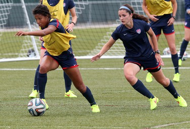Margaret Purce and Kaleigh Riehl take part in a Team United States U-20 Women's National Team practice at Mill Woods Park, in Edmonton Alta., on Monday Aug. 4, 2014. David Bloom/Edmonton Sun/ QMI Agency