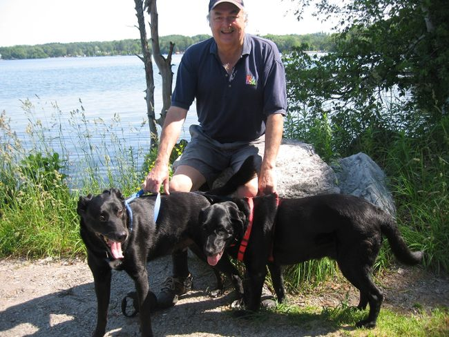 Writer Jim Fox with Cisco and Raven at dog-friendly Bass Lake Provincial Park near Orillia. (Barbara Fox photo)
