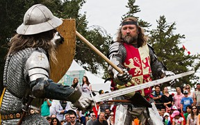 Sir Troy (Dolan), left, does battle with the rebellious Welsh Prince Owain Glyndwr (Tom Yohemas) at the Wales pavilion during Heritage Festival in Hawrelak Park in Edmonton, Alta., on Monday, Aug. 4, 2014. The Welsh Revolt was re-enacted by the Knights of the Northern Realm. Codie McLachlan/Edmonton Sun