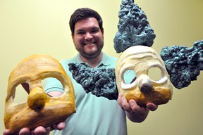 Director Garrett Rodman holds a couple commedia dell'arte-style masks August 7, 2014. They were made specifically for his upcoming production of Mr. Burns, a post-electric play at the McManus Studio Theatre at the end of the month. CHRIS MONTANINI\LONDONER\QMI AGENCY