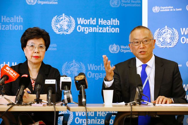 "World Health Organization (WHO) Director-General Margaret Chan (L) sits next to Keiji Fukuda, WHO's assistant director general for health security, as he addresses the media after a two-day meeting of its emergency committee on Ebola, in Geneva August 8, 2014. West Africa's raging epidemic of Ebola virus is an ""extraordinary event"" and now constitutes an international health risk, the WHO said on Friday.  REUTERS/Pierre Albouy"