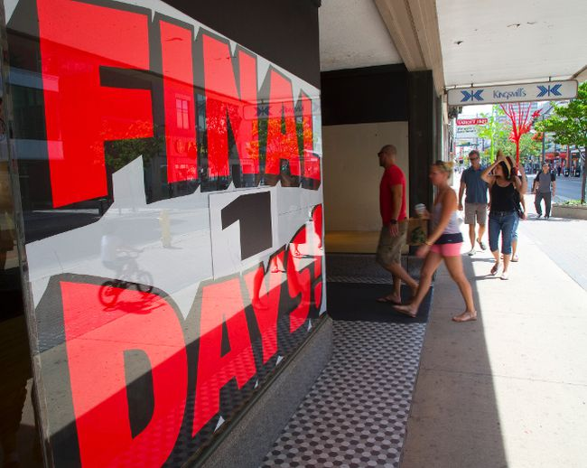 A steady stream of shoppers entered Kingsmills from Dundas on their final day before closing permanently in London, Ont. on Sunday August 10, 2014. 