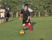 Aaron Hourie of Portage United chases the ball during Portage's 3-2 win over Winnipeg FC Aug.10. (Kevin Hirschfield/The Graphic)