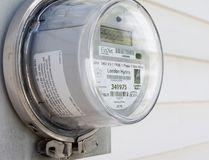 A smart meter made by Sensus hangs on the outside wall of a house in London, Ont. (QMI Agency files)